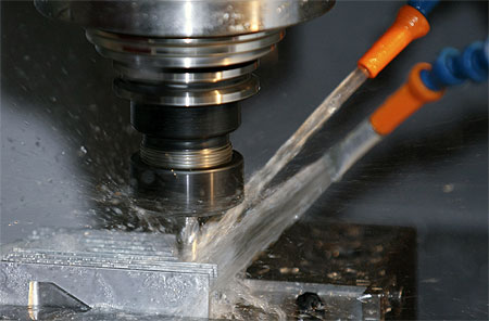 Metal grinding with coolant